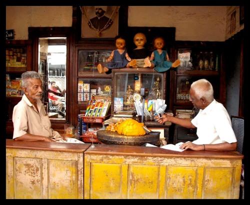 Old men in a shop in Madurai